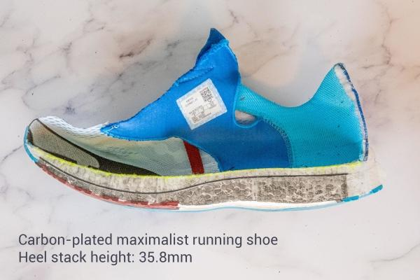Carbon plated running shoe with a maximal stack height